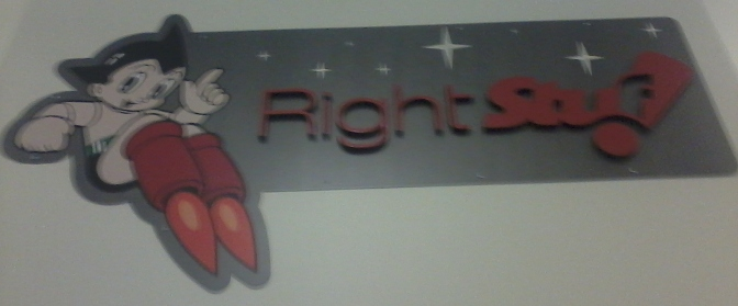The sign in the lobby of Right Stuf with Astroboy accompanying